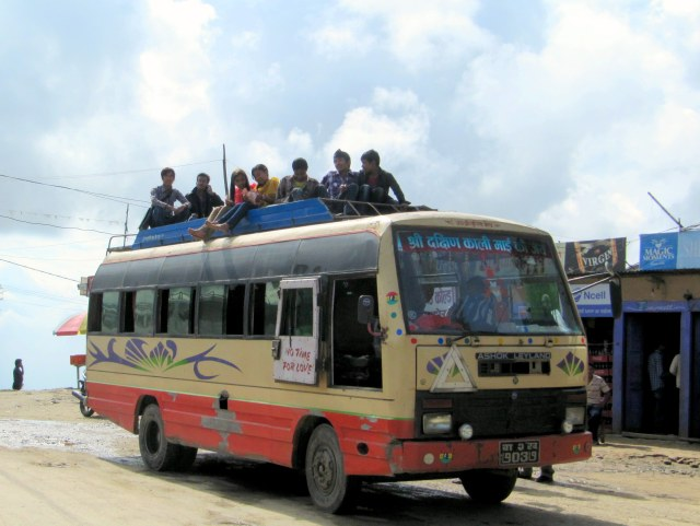 Nepal bus with people on the roof